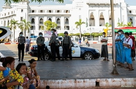 Police stand guard as they wait for protests against coup in Yangon, Myanmar, Feb. 4, 2021.
