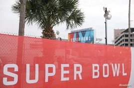 Super Bowl LV signage surrounds Raymond James Stadium ahead of the weekend's Super Bowl LV between the Kansas City Chiefs and…