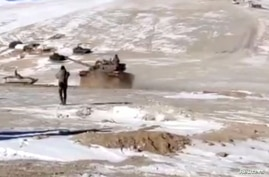 A screenshot from a video shows the disengagement process between Indian Army and China's People's Liberation Army from a…