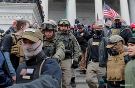 FILE PHOTO: Jessica Marie Watkins  (2nd from L) and Donovan Ray Crowl (Center), both from Ohio, march down the east front steps…