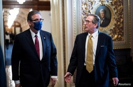 Bruce Castor and Michael van der Veen, lawyers for Trump, walk back to their meeting room during a break through the Senate…