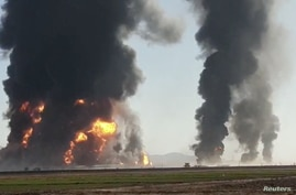 Fire and smoke rise from an explosion of a gas tanker in Herat, Afghanistan February 13, 2021 in this picture obtained by…