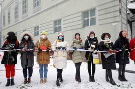 Participants form a human chain during a rally in support of jailed Russian opposition politician Alexei Navalny, his wife…