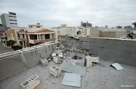 A roof damaged after a barrage of rockets hit in and near Erbil International Airport last night, is seen in Erbil, Iraq…