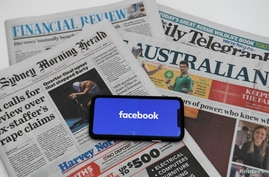 """An illustration image shows a phone screen with the """"Facebook"""" logo and Australian newspapers in Canberra, Australia, February…"""