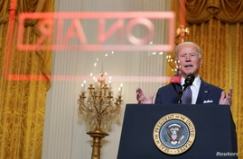 U.S. President Joe Biden delivers online remarks as he takes part in a Munich Security Conference virtual event