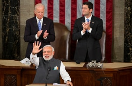 Vice President Joe Biden and House Speaker Paul Ryan of Wis. applaud Indian Prime Minister Narendra Modi during his address to…