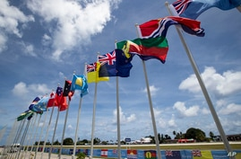 National flags for the Pacific Islands Forum are on display on the tiny Pacific nation of Nauru Monday, Sept. 3, 2018. The…