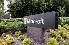 The Microsoft company logo is displayed at their offices in Sydney, Wednesday, Feb. 3, 2021. Microsoft says it supports…