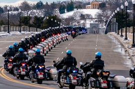 U.S. Capitol Police officers on motorcycles ride ahead of a hearse carrying the remains of U.S. Capitol Police officer Brian…