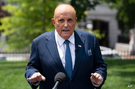 FILE - Rudy Giuliani, personal attorney for then-President Donald Trump, talks with reporters outside the White House, Wednesday,…