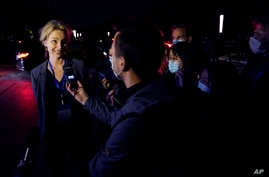 Thea Fischer of the World Health Organization team speaks to journalists outside after a WHO-China Joint Study Press Conference held at the end of the WHO mission in Wuhan, China, Feb. 9, 2021.