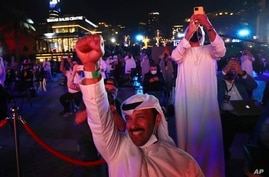 Emiratis celebrate after the Hope Probe enters Mars orbit as a part of Emirates Mars mission, in Dubai, United Arab Emirates,…