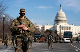 Members of the national guard patrol the area outside of the U.S. Capitol during the impeachment trial of former President.