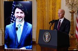 President Joe Biden speaks after holding a virtual meeting with Canadian Prime Minister Justin Trudeau, in the East Room of the…