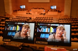 United Nations High Commissioner for Human Rights Michelle Bachelet is seen on a screen as she speaks via video-link during a session of the U.N. Human Rights Council, in Geneva, Feb. 25, 2021.