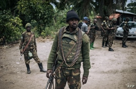 FILE - A Democratic Republic of Congo soldier is seen on patrol in the village of Manzalaho, near Beni, Feb. 18, 2020, following an alleged attack by members of the Allied Democratic Forces (ADF) rebel group.
