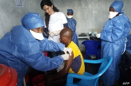 FILE - This handout photo released by Doctors Without Borders (MSF) Nov. 14, 2019, shows a young man receiving an Ebola vaccine at MSF facilities in the North Kivu capital of Goma, DRC. Both Guinea and the DRC are reporting a reemergence of the virus.