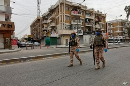 FILE - Iraqi security forces are seen on patrol in central Baghdad, Iraq, April 7, 2020.