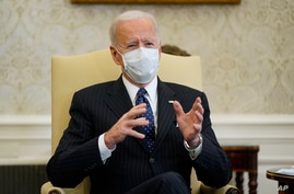 FILE - President Joe Biden meets with business leaders to discuss a coronavirus relief package in the Oval Office of the White House in Washington, Feb. 9, 2021.