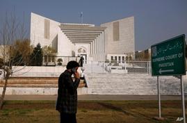 A Pakistani walks past the Supreme Court building in Islamabad, Feb. 10, 2021.