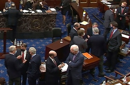 FILE - In this image from video, Republican senators and staff talk on the floor at the second impeachment trial of former President Donald Trump in the Senate, at the U.S. Capitol in Washington, Feb. 13, 2021. (Senate Television via AP)