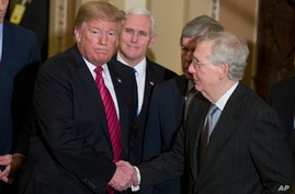 FILE - Then-President Donald Trump, left, shakes hands with then-Senate Majority Leader Mitch McConnell, as he departs, accompanied by then Vice President Mike Pence after a Senate Republican Policy luncheon, on Capitol Hill, in Washington, Jan. 9, 2019.