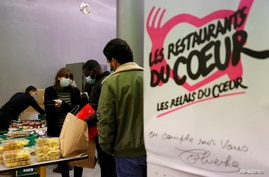 "Students get food during a distribution organized by the French charity ""Les Restos du Coeur"" (Restaurants of the Heart) at a student residence in Paris, France, Feb. 16, 2021."