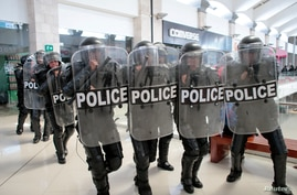 FILE - Riot police prepare to disperse protesters during a rally against Nicaraguan President Daniel Ortega's government, inside Metrocentro mall in Managua, Nicaragua, Feb. 25, 2020.
