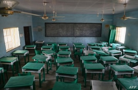 This photograph shows a deserted classroom at the Government Girls Secondary School, the day after the abduction of over 300…