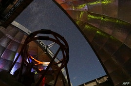 This NASA photo released on March 11, 2021 shows the view from inside the dome of NASA's Infrared Telescope Facility during a…