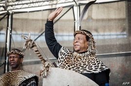 (FILES) In this file photo taken on October 07, 2018 Zulu King Goodwill Zwelithini greets his supporters at The Moses Mabhida…