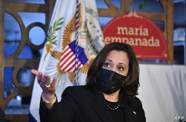 US Vice President Kamala Harris takes part in a small business listening session at Maria Empanada in Denver, Colorado on March…