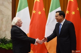 Ireland President Michael Higgins (L) is greeted by Chinese Premier Li Keqiang in Beijing's Great Hall of the People on…