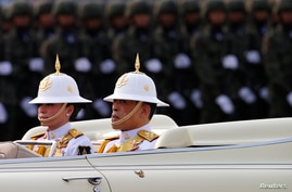 King Maha Vajiralongkorn and Queen Suthida attend the annual Military Parade to celebrate the Coronation of King Rama X at the…