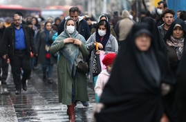 Iranian women wear protective masks to prevent contracting a coronavirus, as they walk at Grand Bazaar in Tehran, Iran February…
