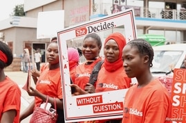 "Young activists at the ""She Decides"" march against sexual violence in Lilongwe, Malawi, on March 2, 2020."