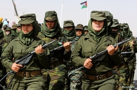 Sahrawi women soldiers carry their weapons and they parade at the Awserd refugee camp in Tindouf, Algeria February 27, 2021…