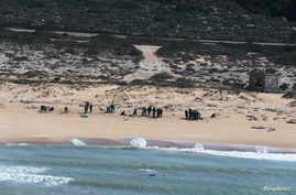FILE PHOTO: An aerial view shows Israeli soldiers cleaning tar from the sand after an offshore oil spill drenched much of…