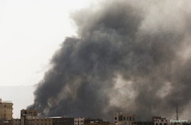 Smoke billows from the site of Saudi-led air strikes in Sanaa, Yemen, March 7, 2021.