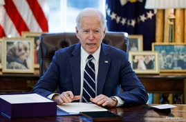 U.S. President Joe Biden signs the American Rescue Plan.
