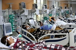 Patients are pictured in the emergency room of the Nossa Senhora da Conceicao hospital that is overcrowding because of the…