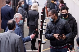 Britain's Prince Charles visits a pop-up COVID-19 vaccination centre at the Finsbury Park Mosque, amid the coronavirus disease …