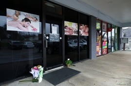 Flowers are seen laid in front of the Young's Asian Massage following the deadly shootings in Acworth, Georgia, U.S. March 17,…