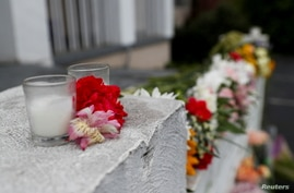 Flowers are laid in front of Gold Spa following the deadly shootings in Atlanta, Georgia, U.S. March 17, 2021. REUTERS/Shannon…