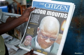 A man holds a newspapers following the death of Tanzania's President John Magufuli in Dar es Salaam, Tanzania March 18, 2021…