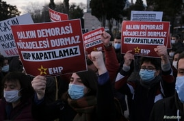 People shout slogans during a demonstration to protest against the court case launched for closure of the pro-Kurdish…