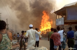 Fire is seen at Balukhali Refugee Camp, in Cox's Bazar, Bangladesh, March 22, 2021, in this picture obtained from social media…