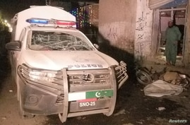 A damaged police vehicle is see after a remote controlled bomb blast in Pakistan-Afghanistan border town of Chaman, Pakistan…