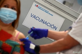 "A sign reading ""Vaccination"" is pictured as Spain resumes vaccination with AstraZeneca shots after a temporary suspension, amid…"